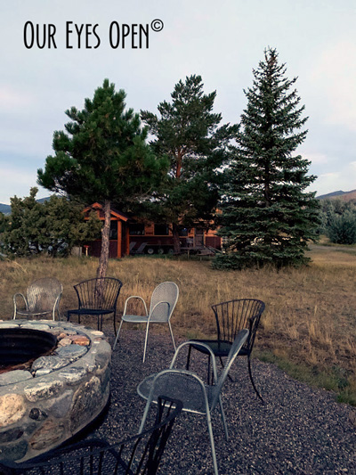 Fire Pit with the tiny house in the background on the property of Paradise Gateway Bed & Breakfast in Emigrant, Montana