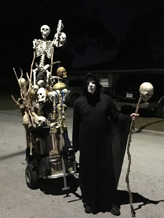 The bone collector with his skeleton staff & bone cart.