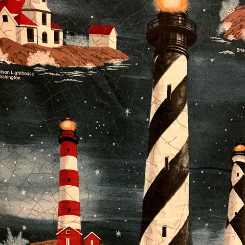 Printed lighthouse quilt.