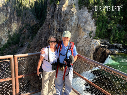Frank and Lisa posing at the bottom of the Lower Falls of the Grand Canyon of Yellowstone National Park.