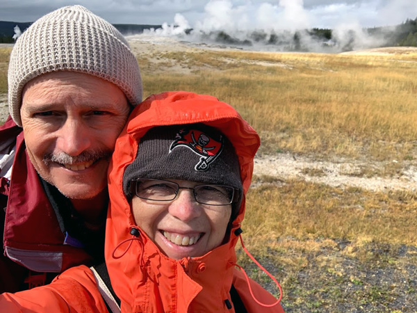 Selfie in front of the geyser basin, Old Faithful, Yellowstone National Park, Wyoming.