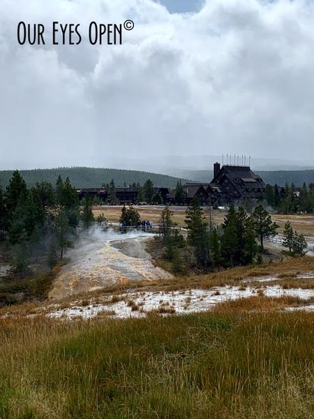 Geyser basin on the grounds of Old Faithful looking towards the Old Faithful Inn at Yellowstone National Park.