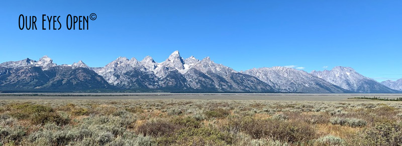 Standing in Teton Valley with a gorgeous view of Grand Teton Mountain Range.