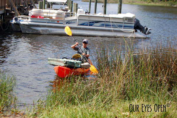 Frank coming in with all the garbage that he picked up and placed in the kayak out of the St. Johns River.