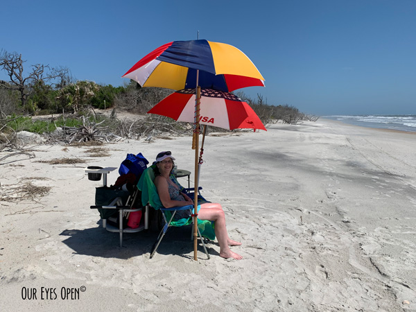 Me, Lisa Coleman sitting under the umbrellas on the beach at Little Talbot Island State Park on Memorial Day Weekend, 2020.