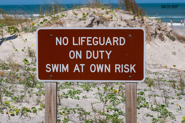 No Lifeguard on Duty, Swim at Own Risk Sign on the boardwalk.
