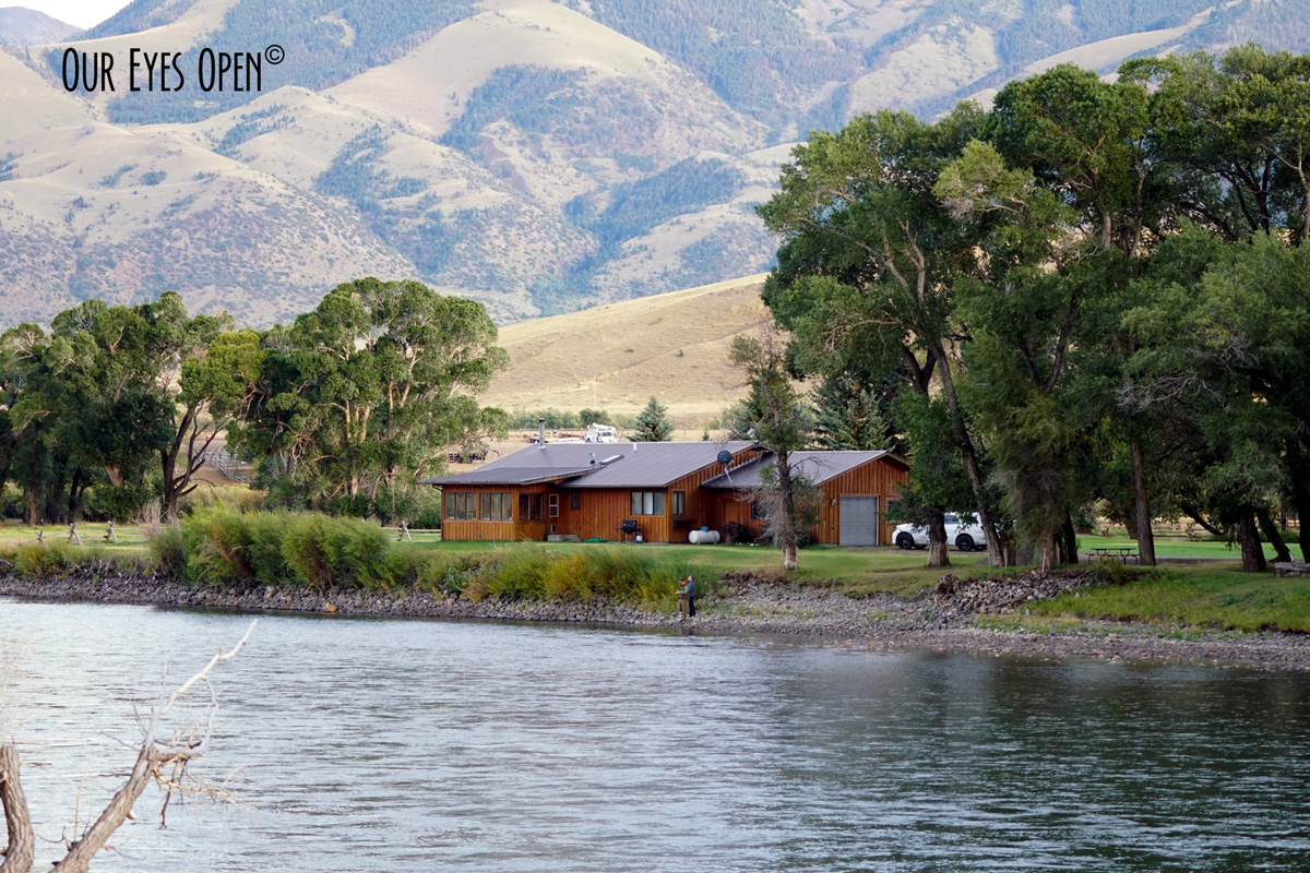 Home sitting on the Yellowstone River with mountains in the backdrop.