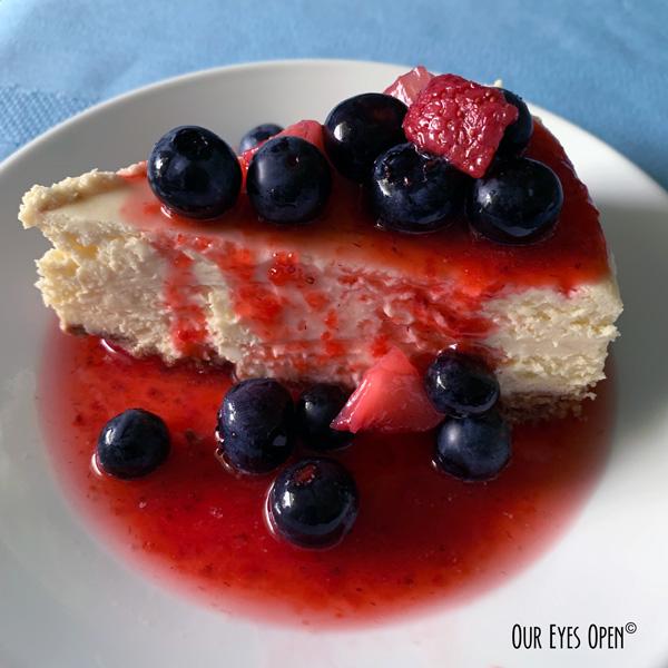 Homemade cheesecake with homemade strawberry freezer jam.