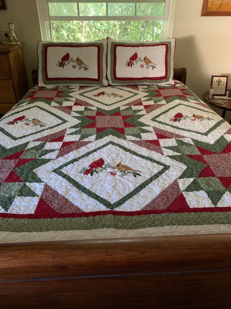 Northern Cardinal quilt with matching shams.