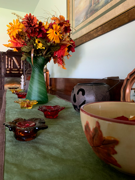 The buffet in the dining room is splashed with fall colors.