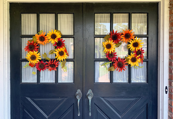 Fall color wreath hanging on my front doors.