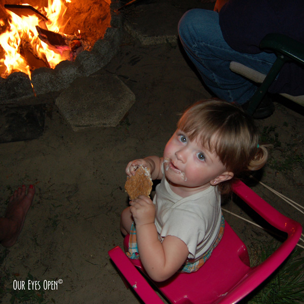Sitting around the campfire enjoying some smores with the granddaughter.