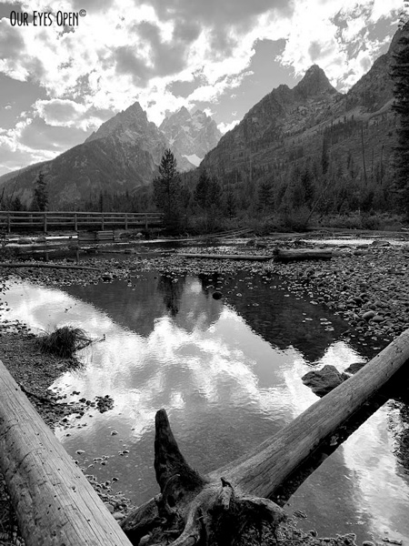 Beautiful reflection of the clouds and mountains at String Lake in Grand Teton National Park.