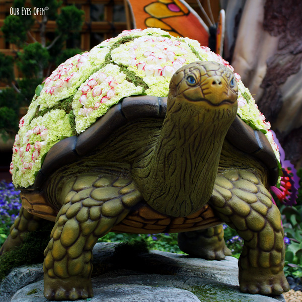 Large turtle sculpture with flowers on its shell at the Bellagio Conservatory & Botanical Gardens in Las Vegas, Nevada.