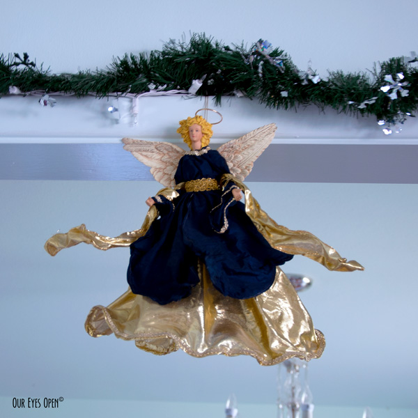 Our angel garnered in navy blue and gold looks upon us every Christmas season.  She is over 30 years old.