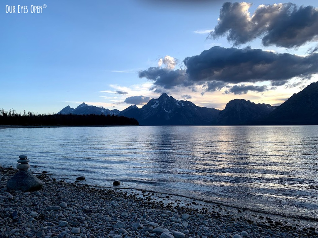 Clouds move past the mountain range at Colter Bay in Grand Teton National Park at sunset.