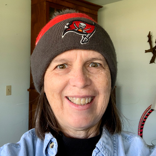 Me with my Tampa Bay Buccaneers Beanie Hat on my head after my hubby found it the next day on the beach.
