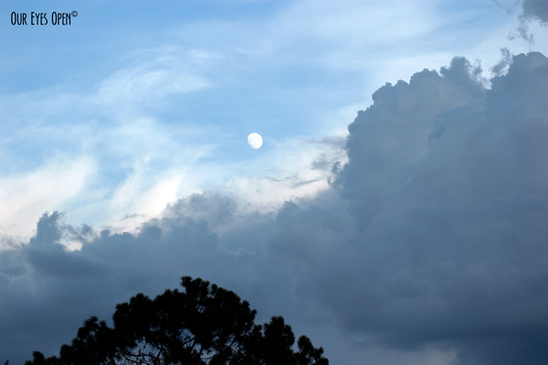Moon rising above storm clouds moving in.