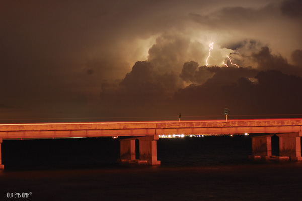 Lighting within an approaching storm in St. Petersburg, Florida from the foot of the Sunshine Skyway Bridge.