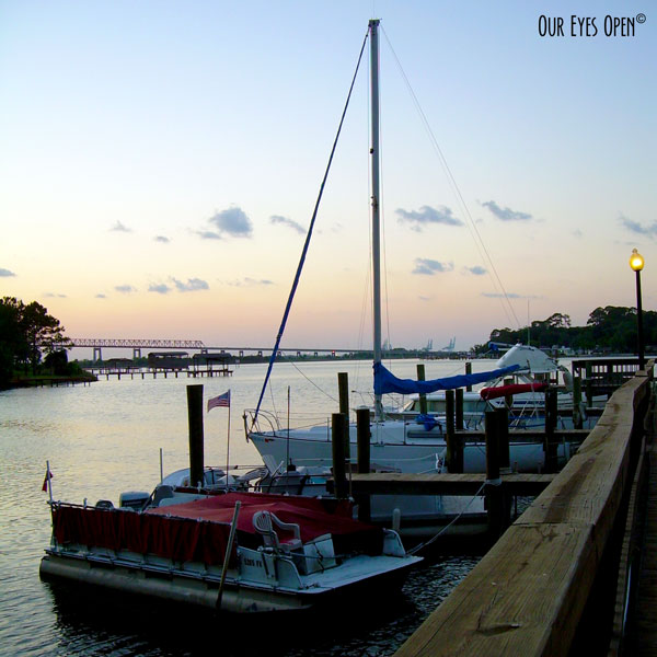 Boats docked overlooking the St. Johns River in Jacksonville, Florida just as the sun is going down.