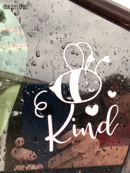 Photo of my hand made Be Kind (Bee Kind) vinyl decal perfect for putting on a glass window. Shop Today! https://etsy.me/38Dufa7