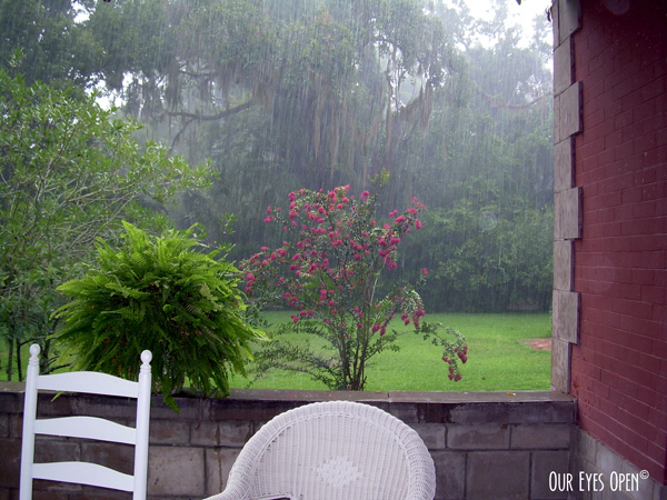 Rain shower while sitting on a covered porch of a bed & breakfast in Micanopy, FL.